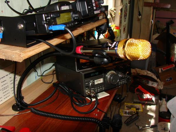 Close up of my new Heil Goldline GM-5 mounted to a goose neck, complete with foot switch...(not seen in photo)... At the bottom of photo is the Heil Handi-Mic-ic that's now connected to an Icom ID-880H on a Heil Short boom with foot switch.....