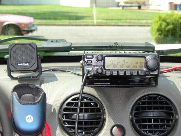 A closer look...the Motorola cell phone pouch is velco'ed to the dash, and holds my phone while driving.....