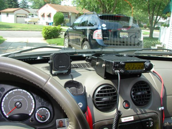 The IC-2200H on the dash with the Rat Shack mini extension speaker next to it. View from the driver's seat....