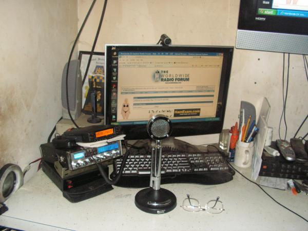 "You can just see the corner of my 42"" widescreen out her in my shack.  Magnum OmegaForce & Astatic D-104/TUP9, Yaesu FT-8800R"