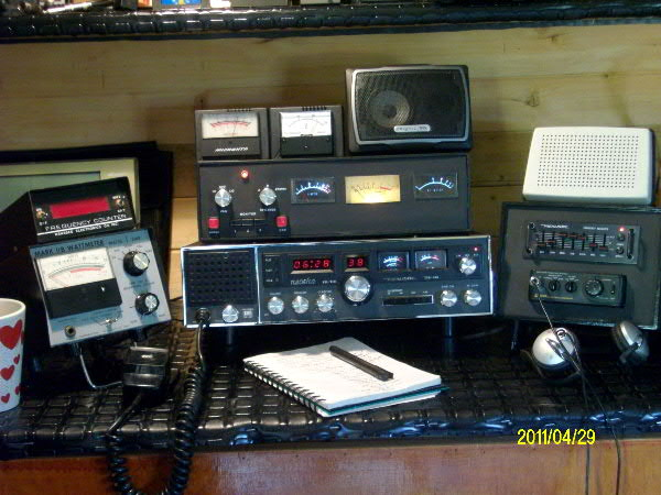 My base radio. Nothing special. Realistic TRC-457 transceiver, Monitor box on top of radio controls fan in radio, equalizer and DSP unit on the right . Stock Realistic handmike. Transel wattmeter, Black Cat counter, external speakers, Altec-Lansing phones