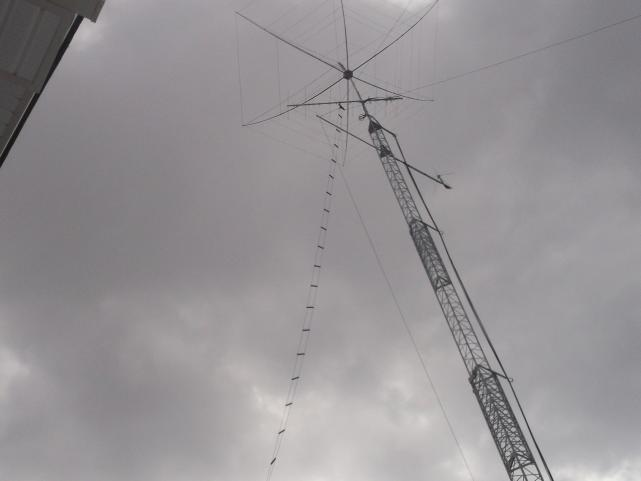 View of Ladder line going up to a stand off on the tower connected to the feed point of the Delta Loop.