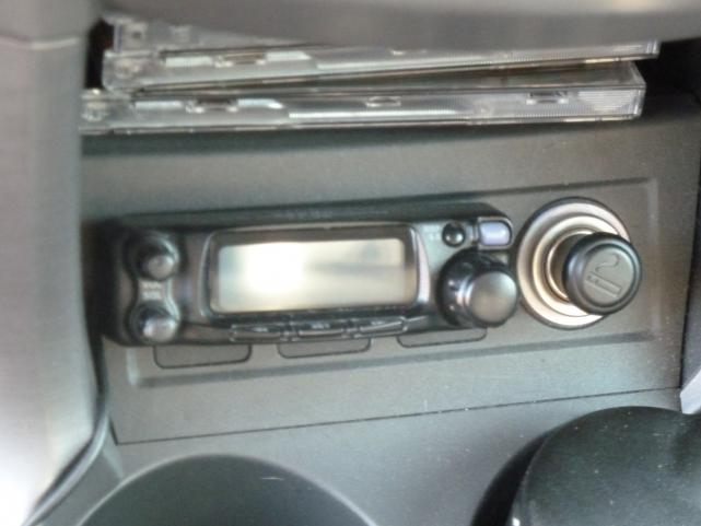 Detachable front panel of FT90R mounted under dash.