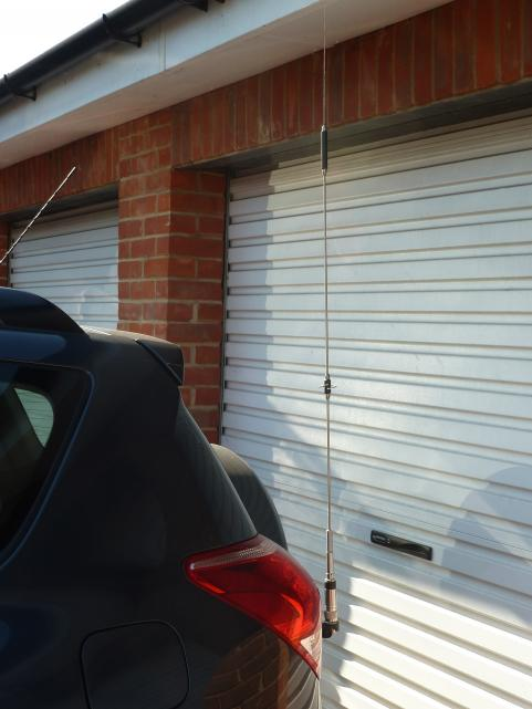 Diamond NR-790 144/430 MHz mobile antenna fitted to rear door of the RAV4. I cut the lip off a Diamond DPK-TR antenna mount so that the door will open and close.