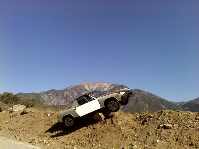 My buddy Robert's Rotary-powered 914. Crashed it on Glendora Mountain Road ... OUCH.   Almost a shear cliff over the edge there ... them big boulders totaled the car, but saved his bacon!