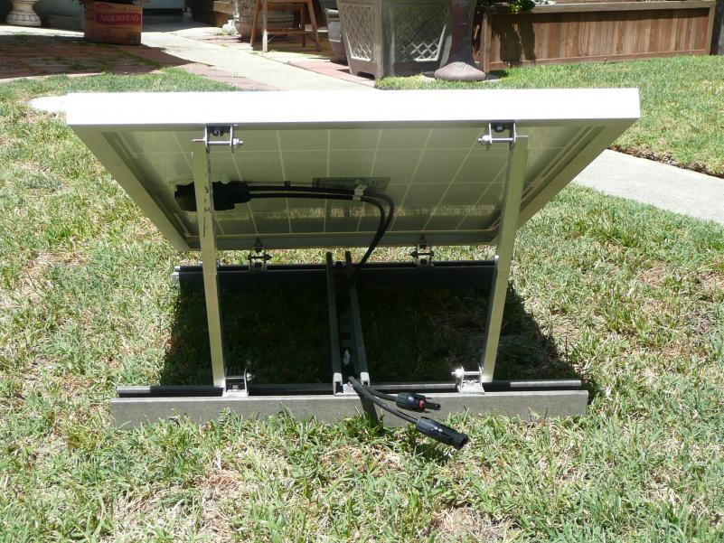 The rack assembly I fabricated for the 40-watt panel (x2).  Racks were fabricated using left over scrap materials. Bases are fiberglass UniStrut, cross member is shallow steel Unistrut. Hinges made from aluminum ''U' channel and struts from some 'L' ang