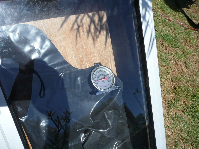 Testing the new solar collector. The temperature inside the box rose to over 200F degrees in less than 30 minutes ... better than I thought it would produce.