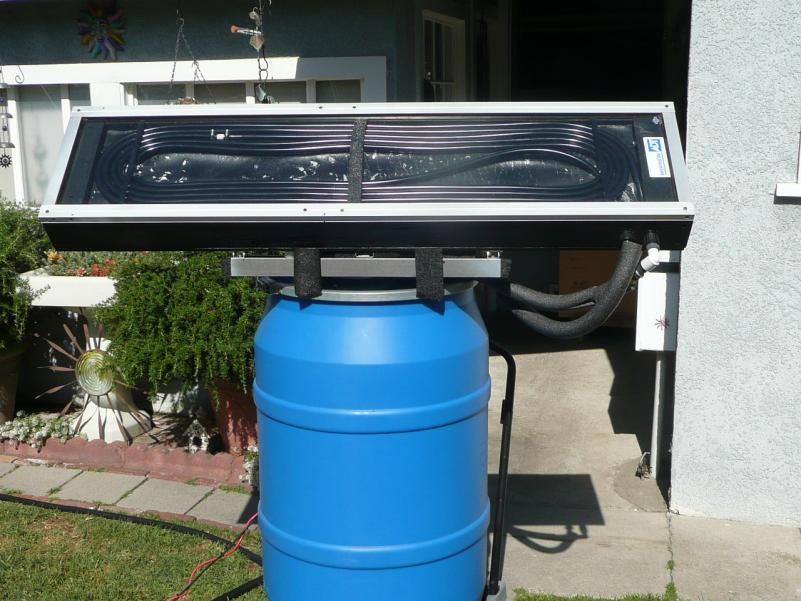 """First test of the solar water heater with the new design collector. I used 40 feet of 1/2"""" ID black vinyl pond hose coiled inside."""